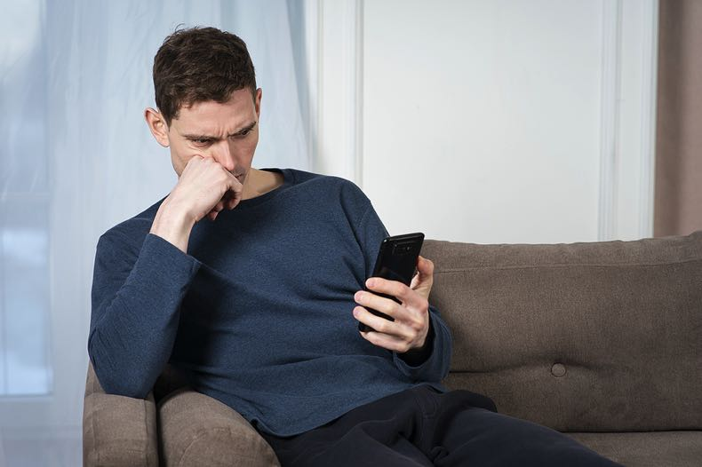 Troubled man on mobile phone